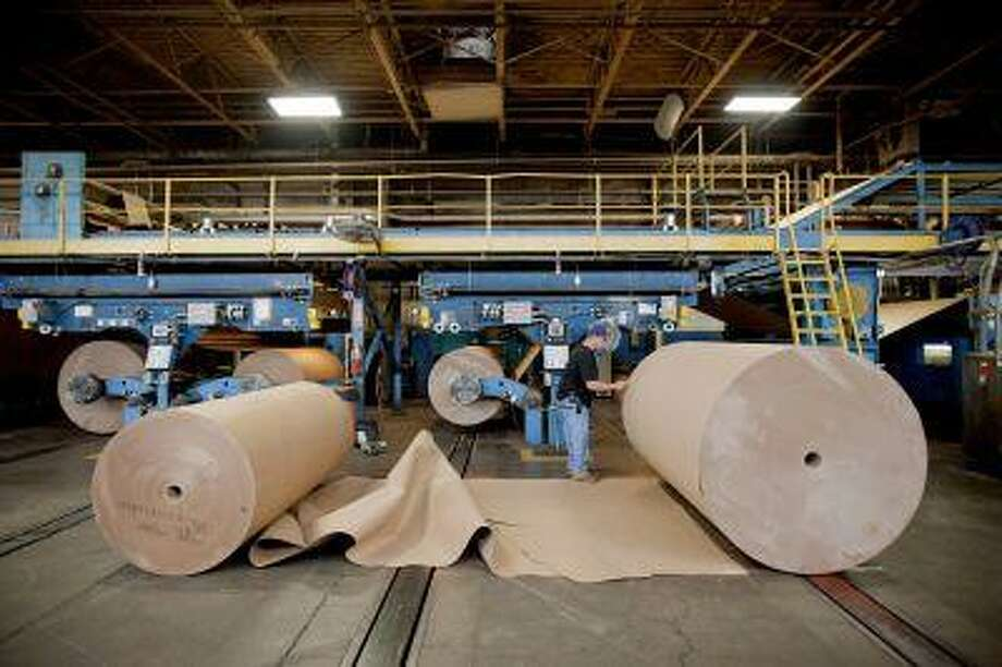 An International Paper Co. employee works on the floor of the company's factory in Mount Carmel, Pa. Photo: BLOOMBERG NEWS / BLOOMBERG NEWS