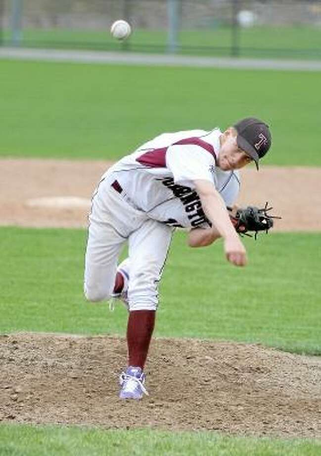Marianne Killackey/Special to Register Citizen  Torrington freshman Nathan Manchester pitches for the Raiders. / 2013