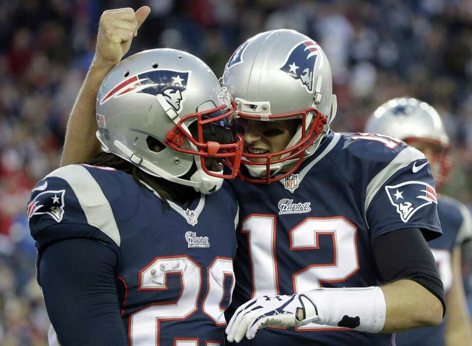 New England Patriots quarterback Tom Brady, right, congratulates running back LeGarrette Blount on his touchdown in the fourth quarter of Sunday's game against the Detroit Lions in Foxborough, Mass. The Patriots won 34-9. Photo: Steven Senne — The Associated Press  / AP