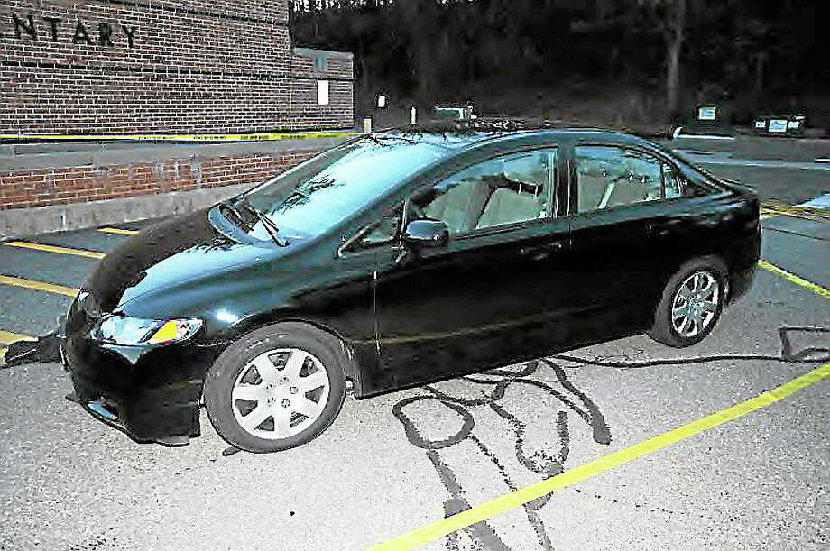 Adam Lanza's car outside Sandy Hook Elementary School. Division of Criminal Justice photo Photo: Journal Register Co.
