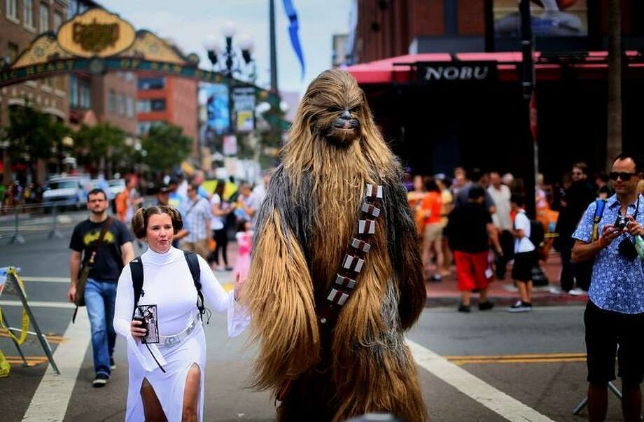 SAN DIEGO, CA - JULY 19: Star Wars characters walk down 5th Avenue during Comic Con on July 19, 2013 in San Diego, California.  Comic Con International Convention is the world's largest comic and entertainment event and hosts celebrity movie panels, a trade floor with comic book, science fiction and action film-related booths, as well as artist workshops and movie premieres. (Photo by Sandy Huffaker/Getty Images) Photo: Getty Images / 2013 Getty Images