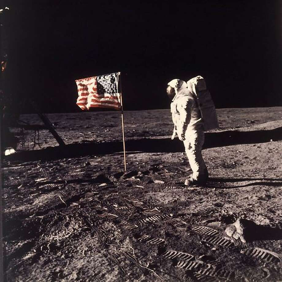 "Astronaut Edwin E. ""Buzz"" Aldrin Jr.  poses for a photograph beside the U.S. flag deployed on the moon during the Apollo 11 mission on July 20, 1969.  Aldrin and fellow astronaut Neil Armstrong were the first men to walk on the lunar surface with temperatures ranging from 243 degrees above to 279 degrees below zero.  Astronaut  Michael Collins flew the command module.  The trio was launched to the moon by a Saturn V launch vehicle at 9:32 a.m. EDT, July 16, 1969. They departed the moon July 21, 1969. (AP Photo/NASA/Neil A. Armstrong) Photo: AP / 1969 AP"