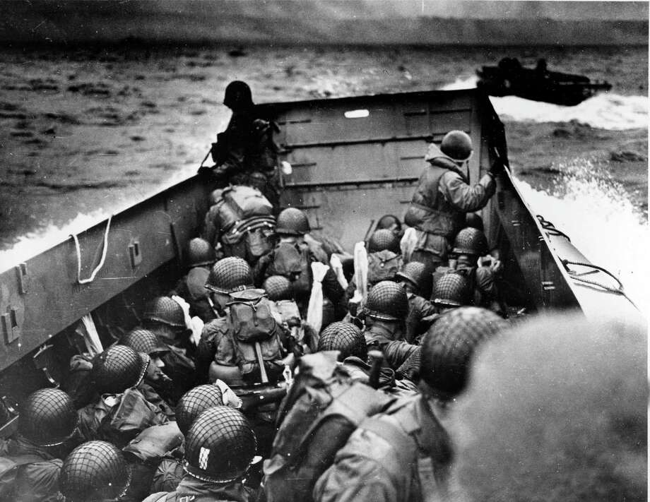 FILE - In this June 6, 1944, file photo, Allied troops crouch behind the bulwarks of a landing craft as it nears Omaha Beach during a landing in Normandy, France. (AP Photo/U.S. Coast Guard, File) Photo: AP / U.S. Coast Guard