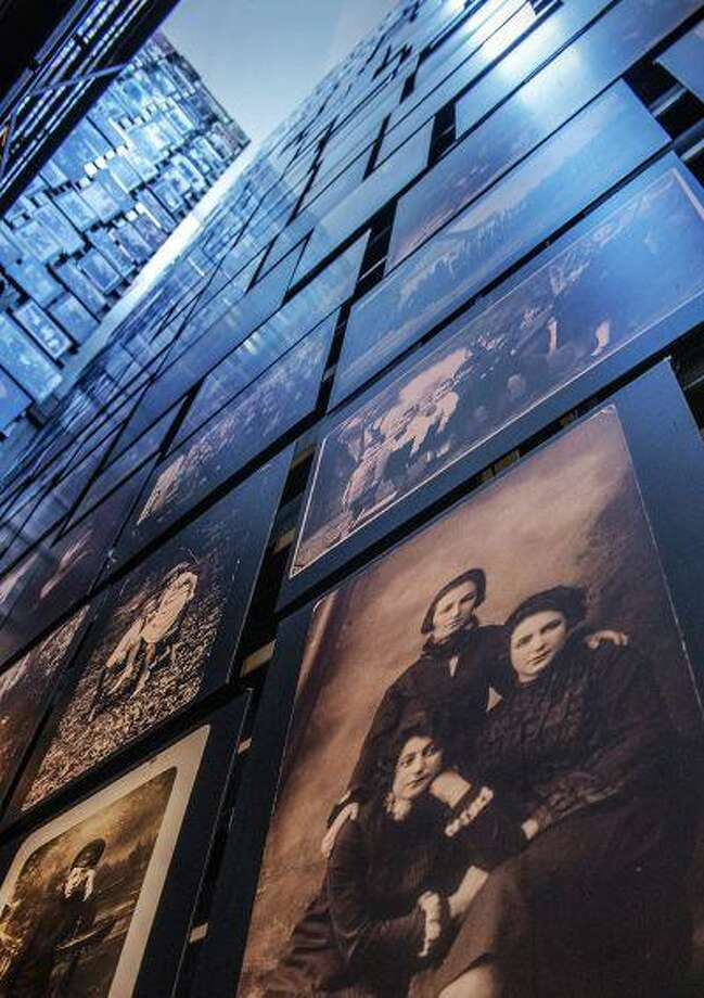 The Tower of Faces at the Holocaust museum; the pictures are of citizens of Eishishok, a small town in what is now Lithuania, whose Jewish population was murdered by an SS mobile killing squad. Illustrates MUSEUM-HOLOCAUST (category e), by Lonnae O'Neal Parker (c) 2013, The Washington Post. Moved Friday, April 26, 2013. (MUST CREDIT: Washington Post photo by Bill O'Leary.) Photo: THE WASHINGTON POST / THE WASHINGTON POST