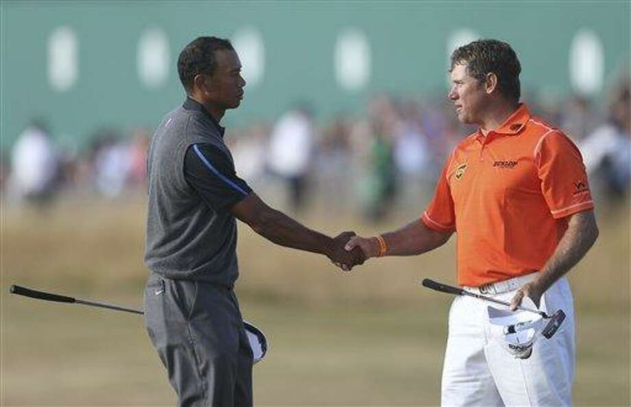 Tiger Woods of the United States, left, shakes hands with Lee Westwood of England on the 18th green after their third round of the British Open Golf Championship at Muirfield, Scotland, Saturday July 20, 2013. (AP Photo/Scott Heppell) Photo: AP / AP