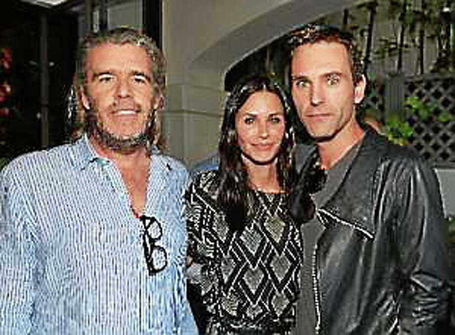 "Author Kevin Morris, actress Courteney Cox and songwriter Johnny McDaid attend Kevin Morris' ""White Man's Problem"" book release party on June 3, 2014 in Los Angeles. Photo: (Alberto E. Rodriguez — Getty Images)"