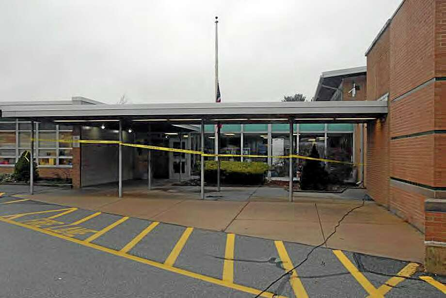 """This image contained in the """"Appendix to Report on the Shootings at Sandy Hook Elementary School and 36 Yogananda St., Newtown, Connecticut On December 14, 2012"""" and released Monday, Nov. 25, 2013, by the Danbury, Conn., State's Attorney shows a scene outside the entrance to Sandy Hook Elementary School in Newtown, Conn. Adam Lanza opened fire inside the school killing 20 first-graders and six educators before killing himself as police arrived. (AP Photo/Office of the Connecticut State's Attorney Judicial District of Danbury) Photo: AP / Office of the Connecticut State's Attorney Judicial District of"""
