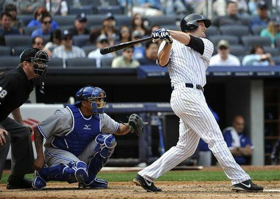 New York Yankees' Lyle Overbay, right, hits a two-run home run off Toronto Blue Jays starting pitcher R.A. Dickey in the seventh inning of a baseball game at Yankee Stadium, Sunday, April 28, 2013, in New York. (AP Photo/Kathy Kmonicek) Photo: AP / FR170189 AP