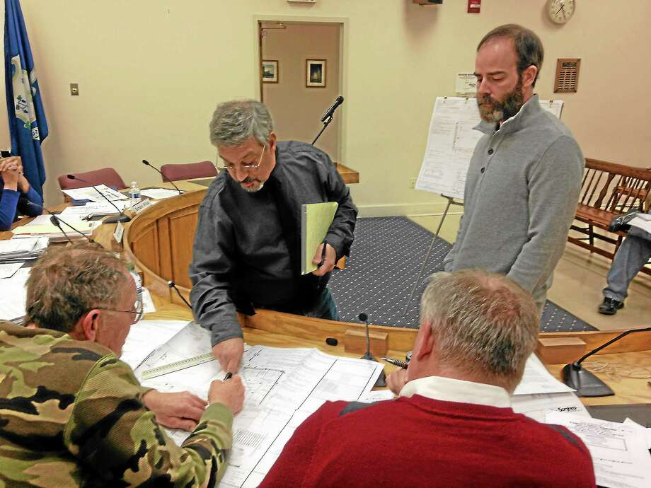 Micheal Renzullo, right, and his engineer present plans for the Capitol Products Co. building to the Winsted Planning and Zoning Commission for the 10th time. The plan was approved on Nov. 25, 2013. Photo: Mercy Quaye — Register Citizen