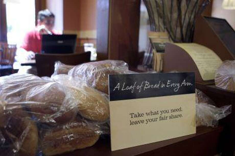 In this May 18, 2010, file photo loaves of bread sits on a table at a Panera Bread Co. restaurant in Clayton, Mo. Photo: AP / AP