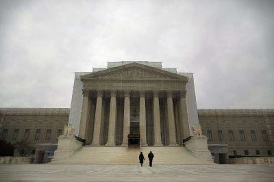 People walk in front of the Supreme Court building in Washington, March 24, 2013. (Jonathan Ernst/Reuters) Photo: REUTERS / X01676