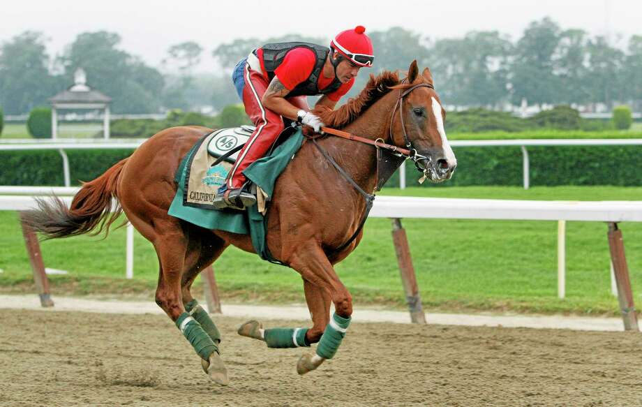 Exercise rider Willie Delgado gallops California Chrome on a second lap during a workout at Belmont Park on Wednesday in New York. The Kentucky Derby and Preakness Stakes winner will attempt to become the first Triple Crown winner since Affirmed in 1978 when he races in the 146th running of the Belmont Stakes on Saturday. Photo: Peter Morgan — The Associated Press  / AP