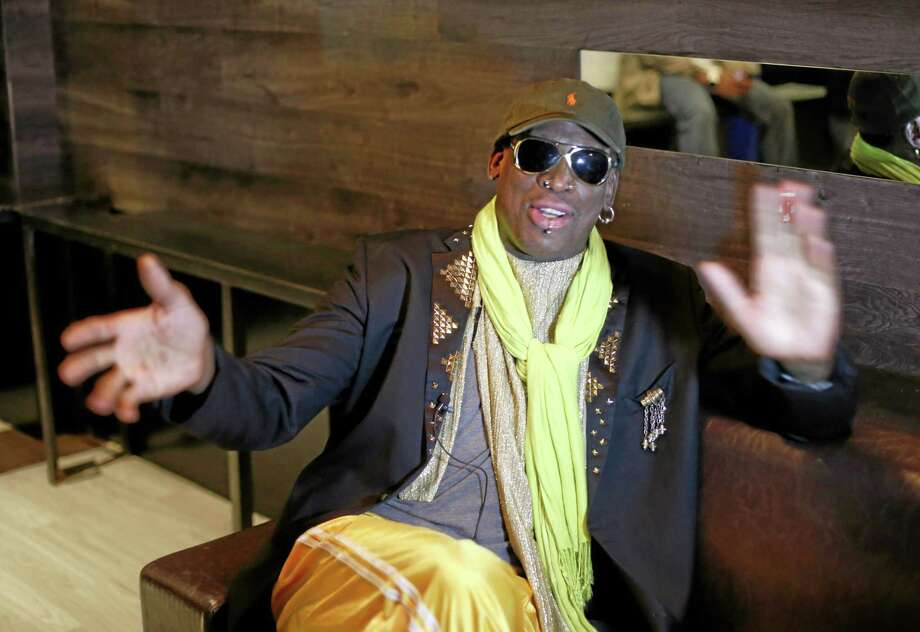 """Dennis Rodman gestues during an interview after a promotional event to pitch a vodka brand in Chicago. Rodman looked fit and at ease, not squirming even once _ a childhood habit that earned the nickname """"The Worm."""" AP Photo/Charles Rex Arbogast Photo: AP / AP"""