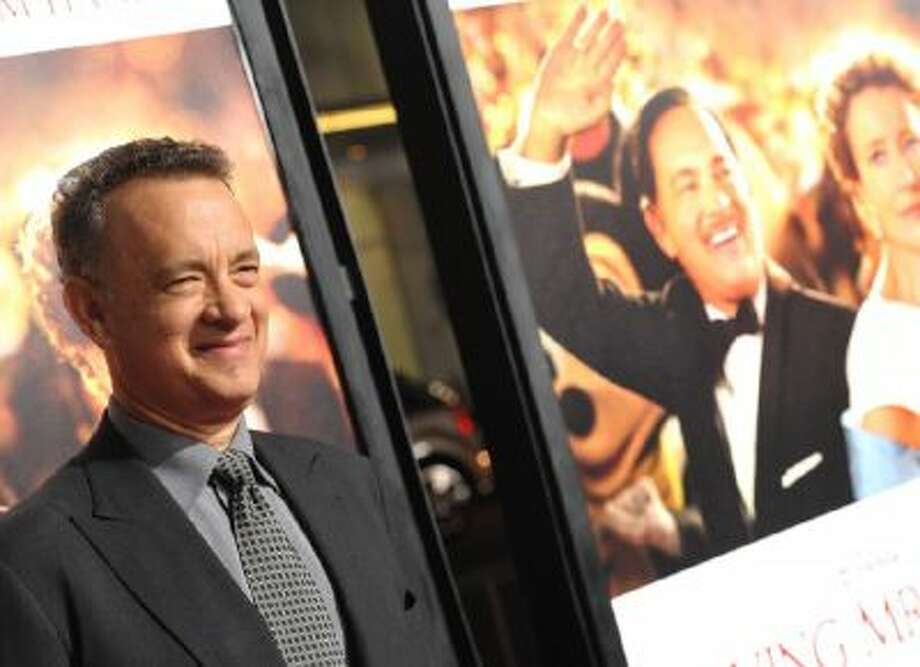 "Tom Hanks arrives on the red carpet for the 2013 AFI Fest's premiere of ""Saving Mr. Banks"" at the TCL Chinese Theatre on Thursday, Nov. 7, 2013, in Los Angeles."