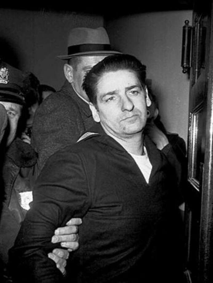 FILE - This Feb. 25, 1967, file photo shows self-confessed Boston Strangler Albert DeSalvo minutes after his capture in Boston. DeSalvo confessed to the string of 1960s killings but was never convicted. He died in prison in the 1970s. Massachusetts officials said Thursday, July 11, 2013, that DNA technology led to a breakthrough, putting them in a position to formally charge the Boston Strangler with the murder of Mary Sullivan, last of the slayings attributed to the Boston Strangler. (AP Photo, File) Photo: AP / AP