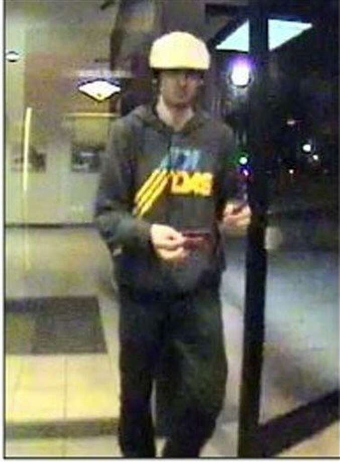 This image taken from surveillance video provided by the Boston Regional Intelligence Center shows Boston Marathon bombing suspect Dzhokhar Tsarnaev at a Bank of America ATM in Watertown, Mass. at 11:18 p.m. on April 18, 2013. The next day, police intercepted Dzhokhar and his 26-year-old brother Tamerlan in a blazing gunbattle that the elder brother dead. Dzhokhar, 19, is charged with carrying out the Boston Marathon bombing April 15 that killed three people and wounded more than 260, and he could get the death penalty. (AP Photo/Boston Regional Intelligence Center) Photo: AP / BRIC