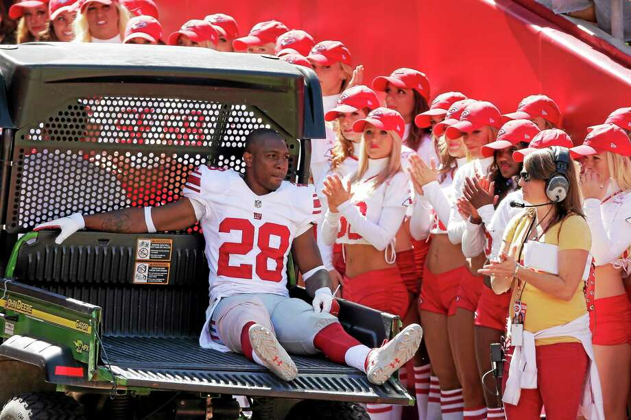 New York Giants cornerback Jayron Hosley is carted off the field after being injured during the first half of a Sept. 29, 2013 game against the Chiefs at Arrowhead Stadium in Kansas City, Missouri. Photo: Charlie Riedel — The Associated Press  / AP