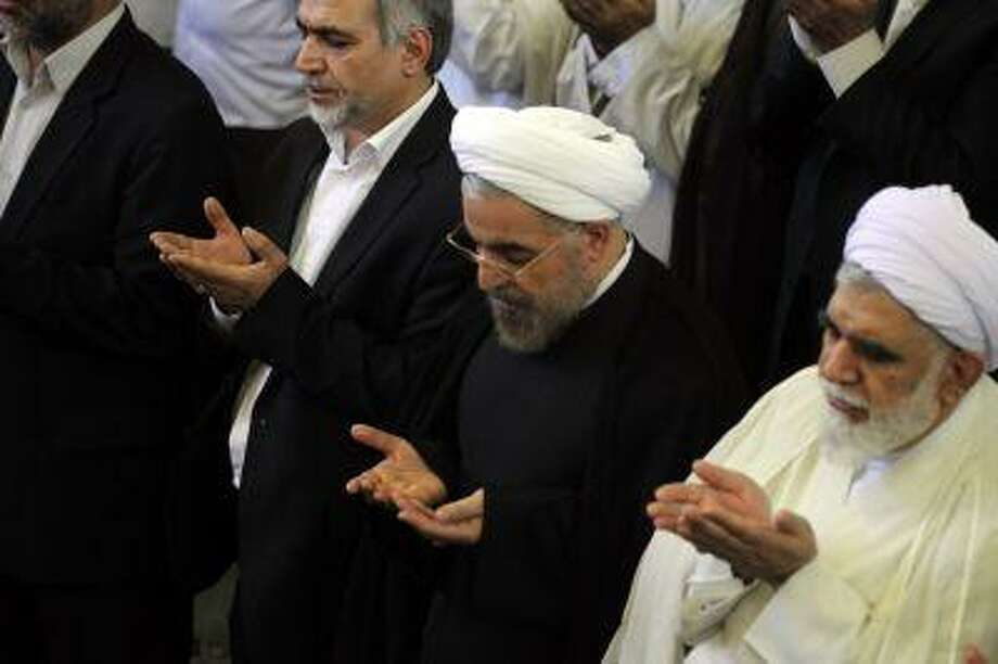 Iranian president-elect Hassan Rowhani attends the weekly Friday prayer with Shiite Muslim worshippers during the Muslim fasting month of Ramadan on July 12, 2013 at the university of the Iranian capital, Tehran. Photo: AFP/Getty Images / 2013 AFP