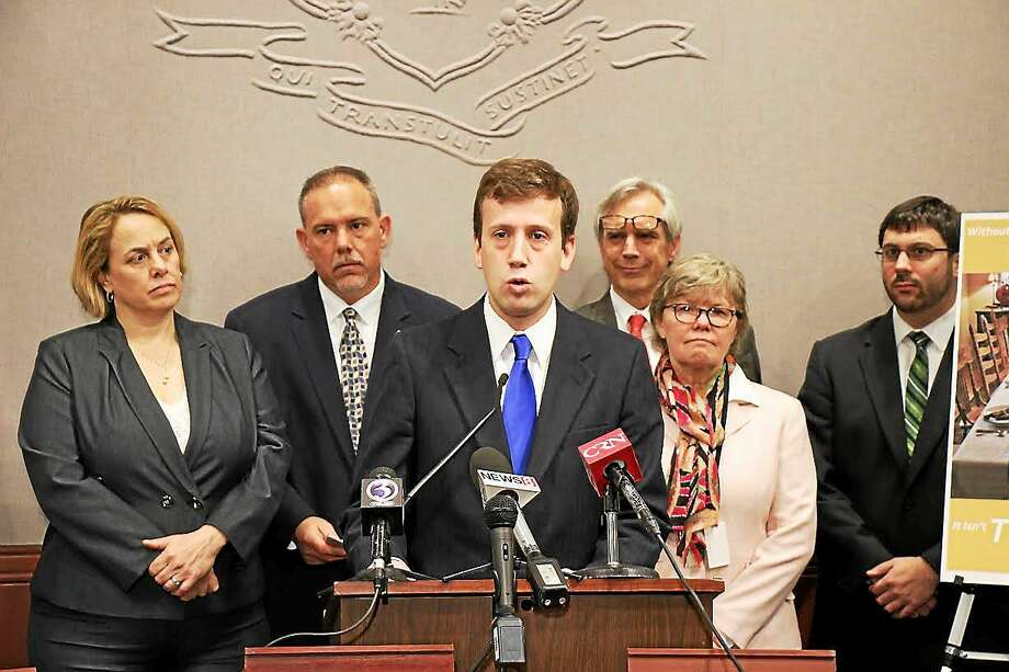 State Rep. Matt Lesser, D-Middletown and other lawmakers at a press conference Monday about a proposal to require any retailer that opens on Thanksgiving to pay workers holiday overtime. Photo: Contributed Photo