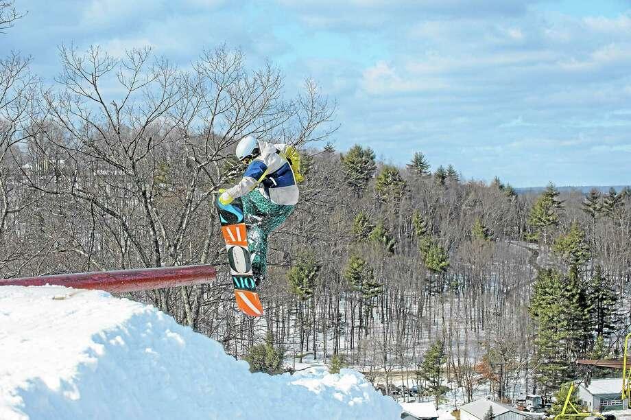 A snowboarder tests a terrain park at Ski Sundown in New Hartford during the 2012-13 ski season. Photo: Contributed Photo — Luke Wayne Photography
