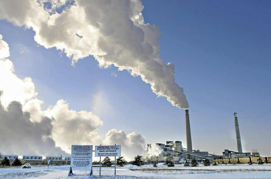 File-This Dec. 5, 2013, file photo shows the Sherco power plant in Becker, Minn. Minnesota, which already successfully lowered carbon emissions and capitalized on renewable energy sources, must cut carbon dioxide emissions by nearly 41 percent over the next 15 years as part of a sweeping plan President Barack Obama announced Monday, June 2, 2014, to reduce pollution from power plants. (AP Photo/St. Cloud Times, Jason Wachter, File) Photo: AP / The St. Cloud Times
