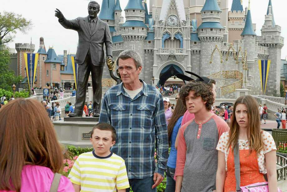 """This image released by ABC shows, from left, Patricia Heaton, Atticus Shaffer, Neil Flynn, Charlie McDermott and Eden Sher from the season finale of """"The Middle."""" The season finale of ABC's comedy """"The Middle"""" proved the power of corporate synergy: the network owned by the Walt Disney Co. gave prime-time attention to an idyllic family vacation at Walt Disney World on the eve of the summer travel season. The Nielsen company said Wednesday's episode was seen by 7.5 million people, the comedy's strongest showing in four months.  (AP Photo/ABC, Todd Anderson) Photo: AP / American Broadcasting Companies, Inc."""