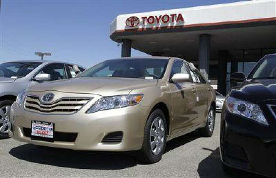 Toyota's Camry has been No. 1 for more than a decade, but the company is being forced to cut prices to keep it there. Camry sales in 2013 fell 2 percent from January through June. Meanwhile its main rivals in the midsize car market - the Honda Accord, Nissan Altima and Ford Fusion - posted big gains. (AP Photo/Paul Sakuma, File) Photo: AP / AP