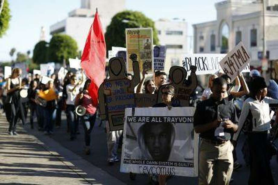 Demonstrators march to protest the acquittal of George Zimmerman in the killing of Florida teen Trayvon Martin in Beverly Hills, California July 17, 2013. Photo: REUTERS / X90045