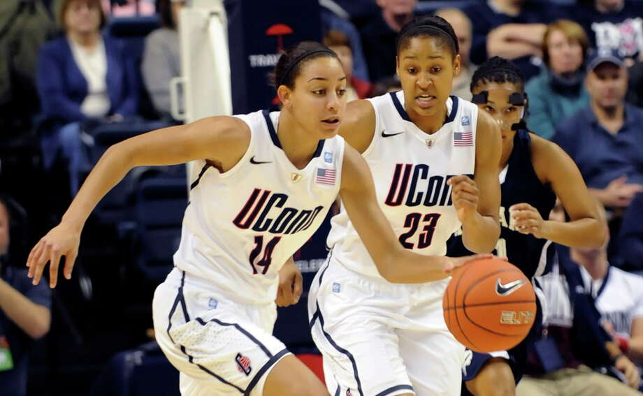 Bria Hartley, left, and Maya Moore were teammates for just one year, back in the 2010-11 season. They are now the only two players in the history of the UConn women's basketball program to record 1,500 points, 500 rebounds, 500 assists and 200 steals. Photo: Bob Child — The Associated Press  / FRE 170410 AP