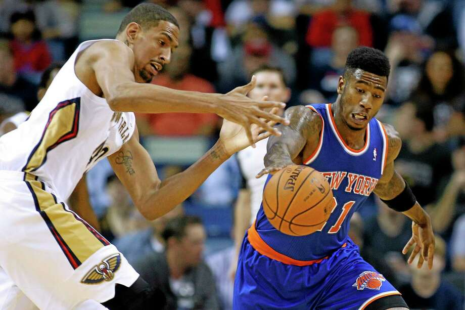 New York Knicks shooting guard Iman Shumpert, right, is expected to miss two weeks with a sprained ligament in his left knee. Photo: Jonathan Bachman — The Associated Press  / FR170615 AP
