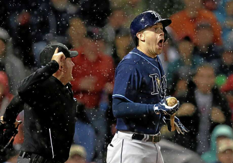 Tampa Bay Rays batter Evan Longoria reacts after narrowly getting hit by a pitch as home plate umpire Dan Bellino immediately tosses Boston Red Sox pitcher Brandon Workman from the game during the sixth inning Friday at Fenway Park in Boston. Photo: Charles Krupa — The Associated Press  / AP