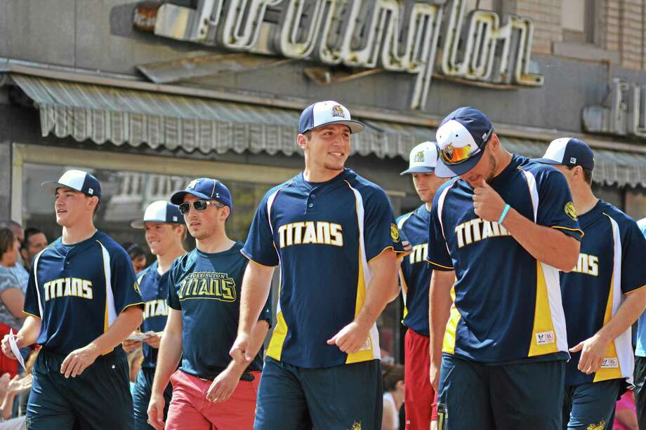 Members of the Torrington Titans walk in Torrington's Memorial Day parade on Monday. Photo: Tom Caprood - The Register Citizen
