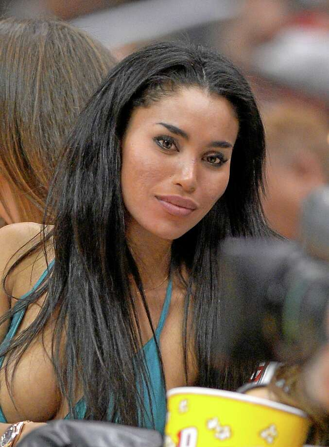FILE -  An Oct. 25, 2013, file photo is of V. Stiviano watching the Los Angeles Clippers play the Sacramento Kings during the first half of an NBA basketball game in Los Angeles.  Stiviano, the woman Los Angeles Clippers owner Donald Sterling was talking to when he made racist remarks says she was assaulted by two men outside a New York City hotel Sunday June 1, 2014.  (AP Photo/Mark J. Terrill) Photo: AP / AP