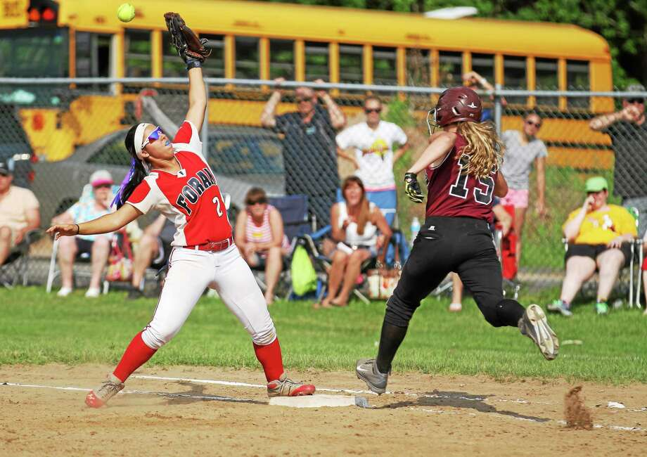 Torrington's Brittany Anderson beats out a single in the Red Raidersí 7-3 win over Foran in the second round of the Class L state tournament. Photo: Marianne Killackey — Special To The Register Citizen  / 2013