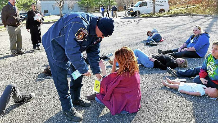 Staff members and emergency personnel take part in a disaster triage training drill at Charlotte Hungerford Hospital in Torrington Saturday, Nov. 22, 2014. Photo: N.F. Ambery — Special To The Register Citizen
