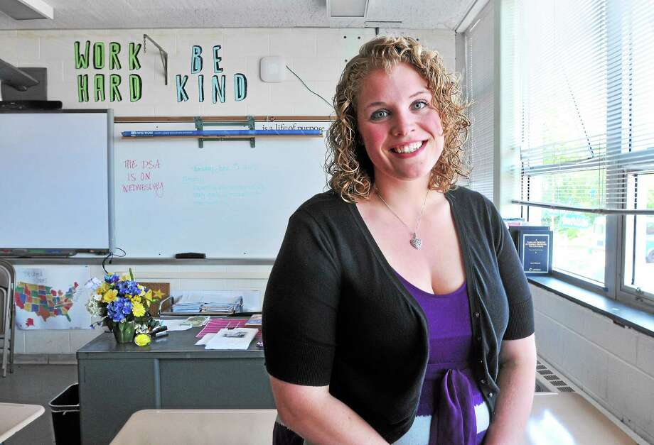 (Arnold Gold-New Haven Register)  Social Studies teacher Kellie  Burkhardt photographed in her classroom on 6/3/2014 was named the Teacher of the Year at Emmett O'Brien Technical High School in Ansonia. Photo: Journal Register Co.
