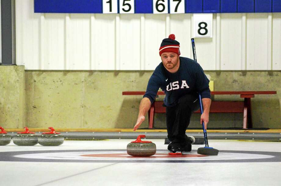 Register Citizen Sports Editor Pete Paguaga during his curling lesson at the Norfolk Curling Club on Wednesday. Photo: John Berry—The Register Citizen