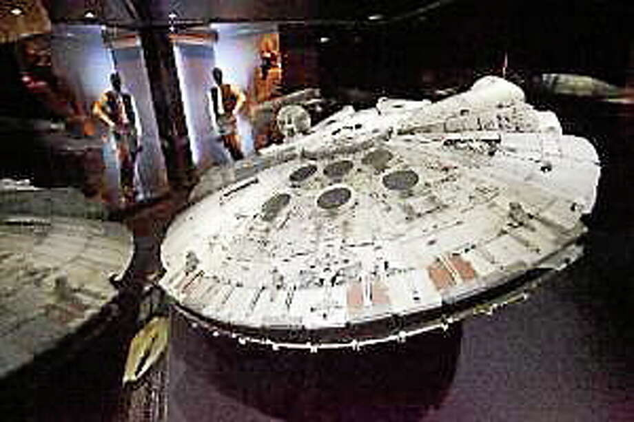 "A model of the Millennium Falcon is one of the displays in ""Star Wars: Where Science Meets Imagination,"" at the Tech Museum of Innovation in downtown San Jose on Oct. 15, 2013. Photo: (Patrick Tehan — Bay Area News Group)"
