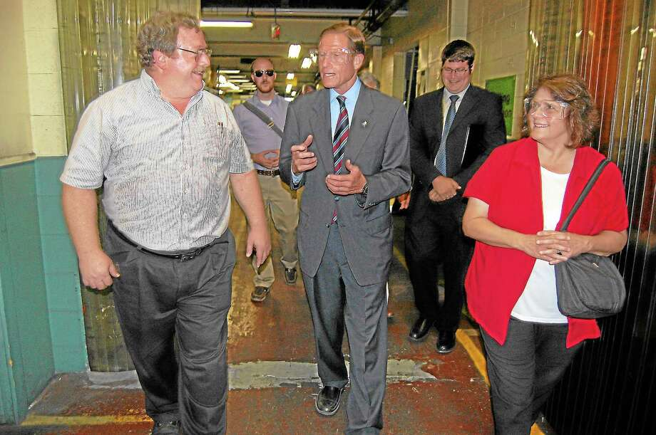 Sen. Richard Blumenthal tours Sterling Sintered Technologies in Winsted. At right is former Mayor Maryann Welcome. Photo: Register Citizen File Photo