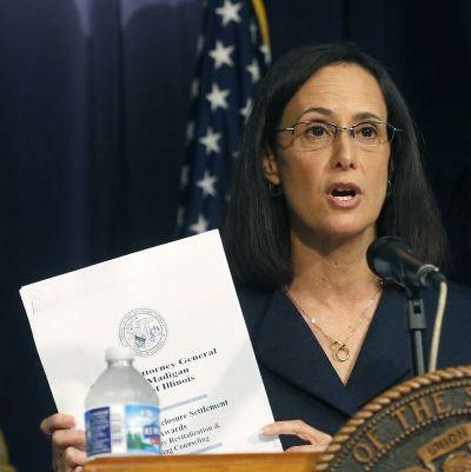 Illinois Attorney General Lisa Madigan announces that her office is distributing $70 million to help Illinois communities hardest hit by the national foreclosure crisis during a news conference Wednesday, July 17, 2013, in Chicago. Photo: AP / AP