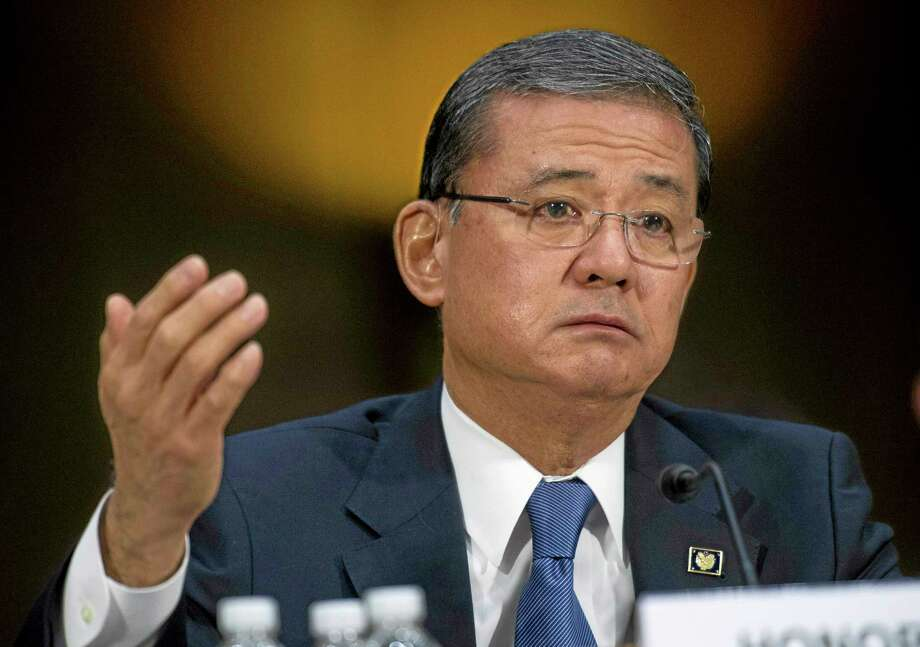 FILE - This May 15, 2014 file photo shows Veterans Affairs Secretary Eric Shinseki testifying on Capitol Hill in Washington. The Department of Veterans Affairs says it will allow more veterans to obtain health care at private hospitals and clinics. Shinseki announced the change Saturday. (AP Photo/Cliff Owen, File) Photo: AP / FR170079 AP
