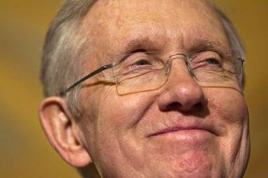 Senate majority leader Harry Reid smiles as he speaks to the media as lawmakers moved toward resolving their feud over filibusters of White House appointees on Capitol Hill in Washington, Tuesday, July 16, 2013. (AP Photo/Jacquelyn Martin) Photo: AP / AP