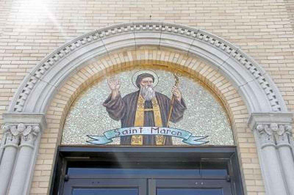 The mural outside the front entrance of the Saint Maron's Church in Torrington on Wednesday, April 24, 2013. The church is scheduled to undergo major renovations, and mass will be held at nearby St. Mary's church. (ESTEBAN L. HERNANDEZ/REGISTER CITIZEN)