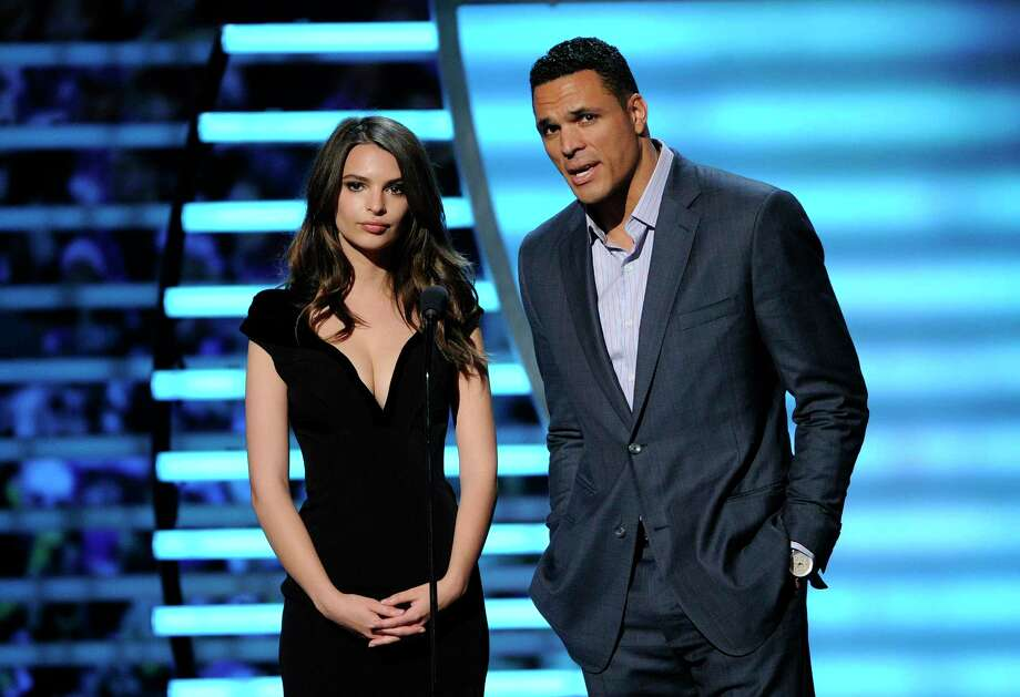 Model Emily Ratajkowski, left, and Tony Gonzalez speak on stage at the 3rd annual NFL Honors at Radio City Music Hall in New York on Feb. 1. Photo: Evan Agostini — Invision For NFL  / Invision