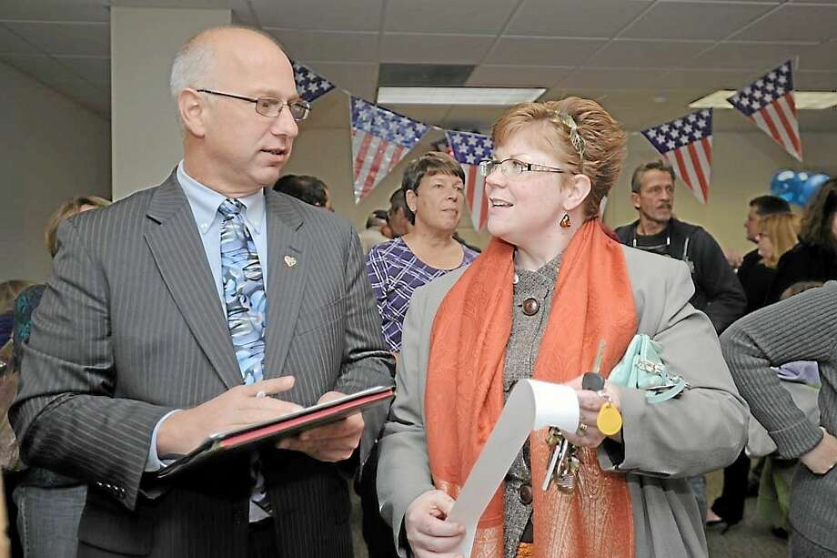 Clark Chapin getting the results in November 2012 in New Milford with Marla Scribner. Photo: File Photo