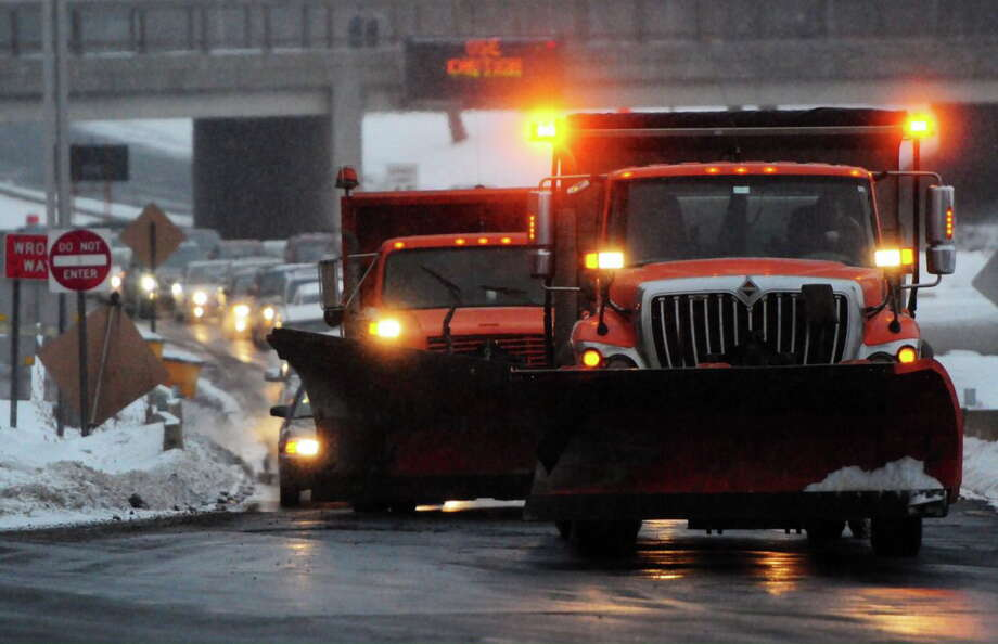 CT DOT trucks lead messy commute into New Haven Tuesday on Oak Street Connector toward College Street. Peter Hvizdak - New Haven Register Photo: Journal Register Co.