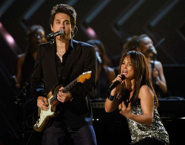 LOS ANGELES, CA - FEBRUARY 10:  Musician John Mayer (L) and singer Alicia Keys perform onstage during the 50th annual Grammy awards held at the Staples Center on February 10, 2008 in Los Angeles, California.  (Photo by Kevin Winter/Getty Images) Photo: Kevin Winter, Getty Images / 2008 Getty Images