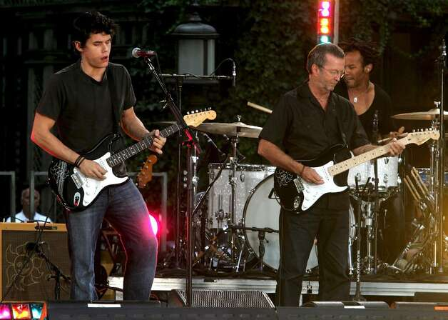 NEW YORK - JULY 20:  (L-R) Musicians John Mayer and Eric Clapton perform on ABC's Good Morning America in Bryant Park on July 20, 2007 in New York City.  (Photo by Peter Kramer/Getty Images) *** Local Caption *** John Mayer;Eric Clapton Photo: Peter Kramer, Getty Images / 2007 Getty Images