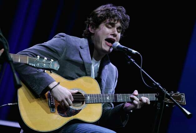 SAN FRANCISCO - JANUARY 11:  Musician John Mayer performs during the keynote address by Apple CEO Steve Jobs at the 2005 Macworld Expo January 11, 2005 in San Francisco, California. Jobs announced several new products including the new Mac Mini personal computer starting at $499 and the iPod shuffle MP3 player for $99. (Photo by Justin Sullivan/Getty Images) Photo: Justin Sullivan, Getty Images / 2005 Getty Images