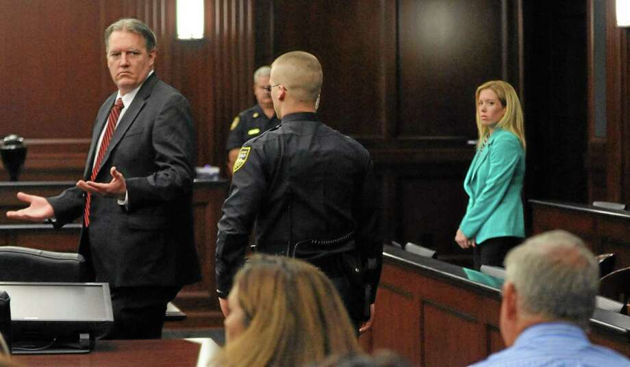 Michael Dunn reacts after the verdict is read in Jacksonville, Fla., Saturday, Feb. 15, 2014. Dunn was convicted of attempted murder in the shooting death of a teenager over an argument over loud music, but jurors could not agree on the most serious charge of first-degree murder. (The Florida Times-Union, Bob Mack, Pool) Photo: AP / Pool, The Florida Times-Union